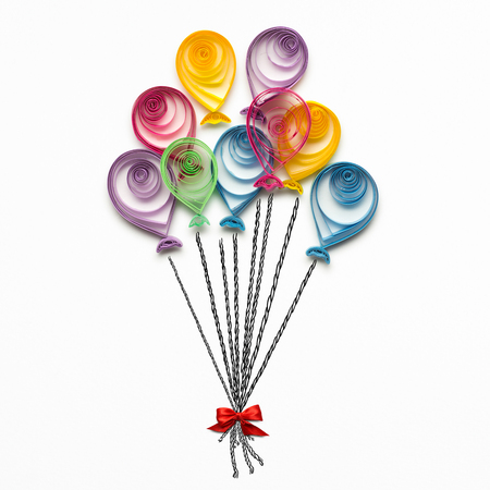 Creative concept photo of quilling balloons made of paper on white background. Stock Photo - 73547012