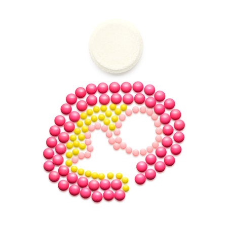 Creative medicine and healthcare concept made of pills, mother breastfeeding baby,  on white background.