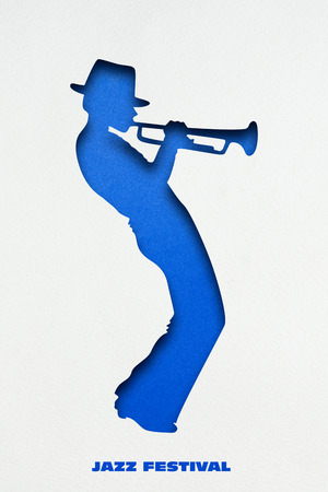 Creative concept photo of trumpet player made of paper on white background. Stock Photo
