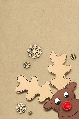 Creative concept photo of a deer made of paper on brown background.