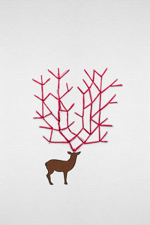 Creative concept photo of a deer made of paper on grey background. Stock Photo
