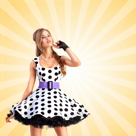 polkadot: Creative vintage photo of a smiling pin-up girl wearing a retro polka-dot dress on colorful abstract cartoon style background.
