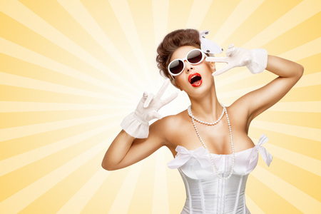 Sexy pinup bride in a vintage wedding corset showing V sign on colorful abstract cartoon style background.