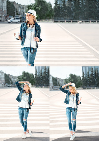 Beautiful young woman in a hat and jeans jacket with a disposable coffee cup, standing on the road with zebra crossing, drinking coffee, and dancing against urban city background.