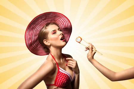 A creative retro photo of a young pin-up girl in bikini eating sushi from chopsticks on colorful abstract cartoon style background.