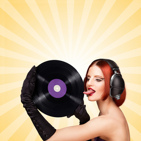 plate: Colorful photo of a sexy girl, wearing huge vintage music headphones and licking a purple LP microgroove vinyl record on colorful abstract cartoon style background.