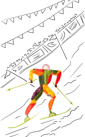 Fruits and vegetables in the shape of a winter skier passing between poles.