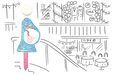 Creative medicine and healthcare concept made of pills, pregnant mother with a baby on sketchy background.