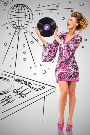 Colorful photo of a clubbing fashionable hippie deejay at the nightclub holding a retro vinyl record in her hands on grey sketchy background of a DJ mixer and disco ball. Stock Photo
