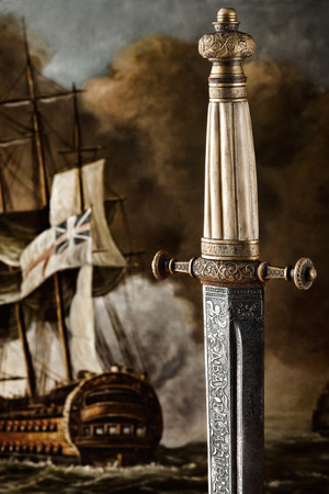 A close-up of an ancient carved sword against painted background. A closeup view of the handle and the blade design of a Slavic dagger from 19th century. Stok Fotoğraf - 77061247