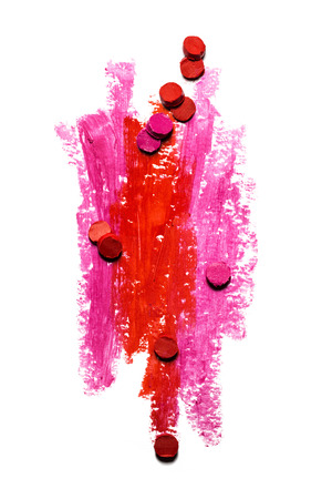 line up: Creative photo of an abstract red and pink strokes with slices of lipstick isolated on white.