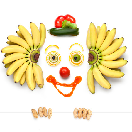 A kind clown made of vegetables and cheese.