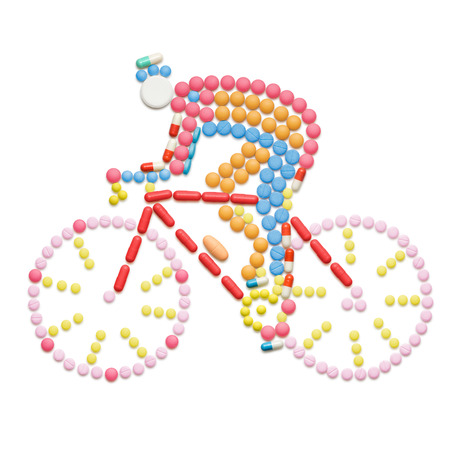 Doping drugs and pills in the shape of a road bicycle racer on a bike. Stock Photo