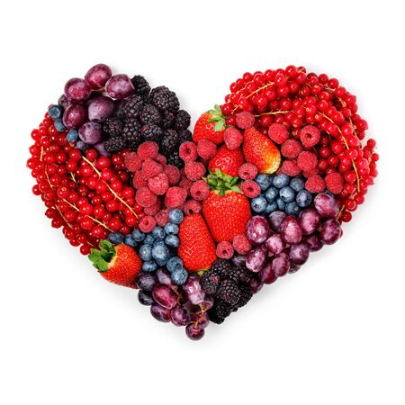 A variety of summer berries in the shape of heart as a symbol of valentine and love.