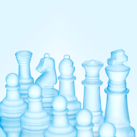 Strategy and tactics concept; icy frosted chess figures standing in a row ready for game