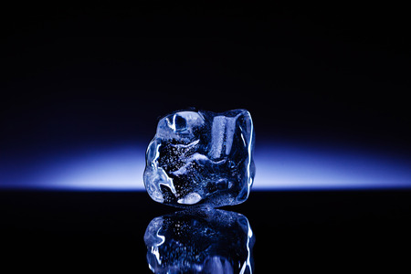 cold: A professionally formed piece of ice on reflecting surface.