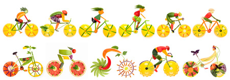 Fruits and vegetables in the shape of bike set with cyclists.