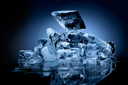 A professionally formed piece of ice on reflecting surface.
