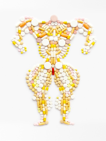 Doping drugs and steroid hormones in the shape of a muscular bodybuilder.