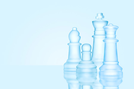 Strategy and leadership concept; frosted chess figures made of ice, standing together ready for game as on a family photo. Stock Photo