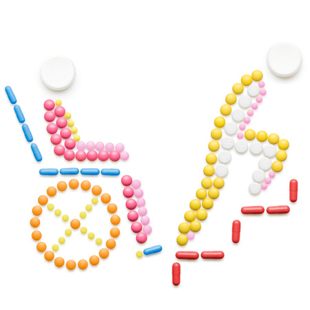 Healthcare concept made of drugs and pills, isolated on white. Helpless person in a wheelchair in front of stairs.