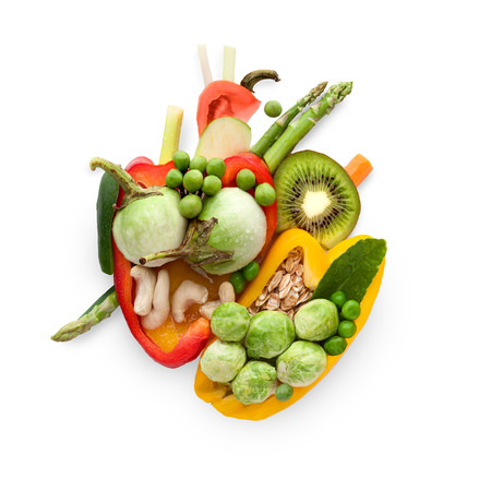 fruit: A healthy human heart made of fruits and vegetables as a food concept of smart eating.