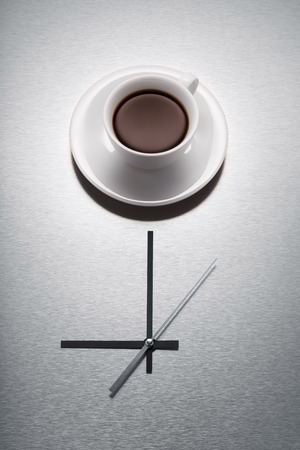 Close-up of Coffee and Clock