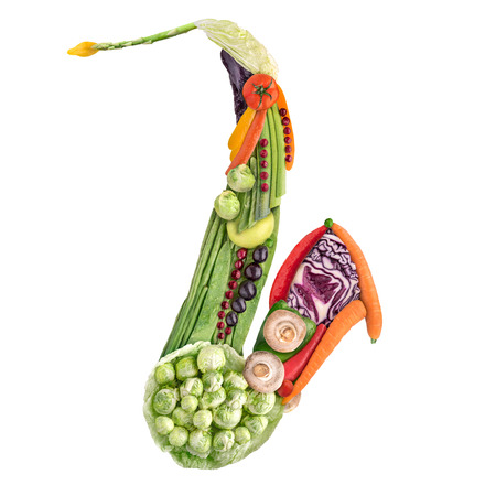raw: Healthy food concept of classical wind instrument saxophone made of fresh vegetables full of vitamins, isolated on white.