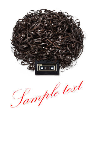 Lenny Kravitz - A head with afro hairdress made of audio tape. Stock Photo