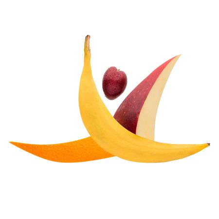Fruits arranged in a gymnast shape jumping a split leap.
