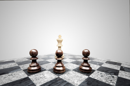 Three pawns in a raw standing in front of king shape.