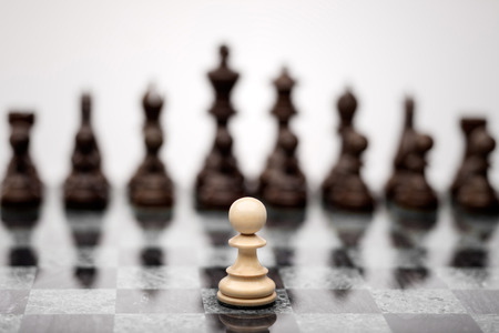 A pawn on the chequer before the shapes. 版權商用圖片