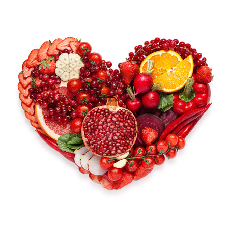 Healthy food concept of a human heart made of vegetable and fruit mix that reduce death risk, isolated on white.