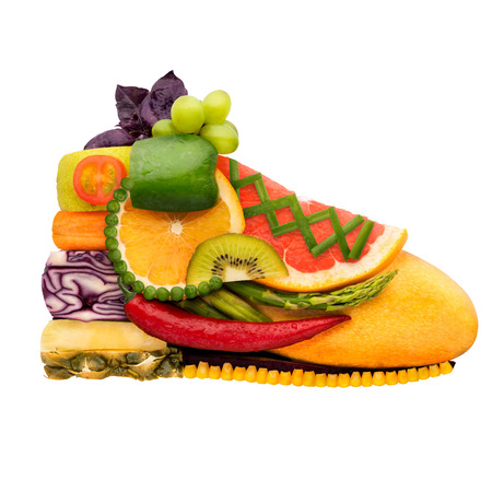 fruit: Fruits and vegetables in the shape of a tasty shoe trainer for running, food concept isolated on white background. Stock Photo