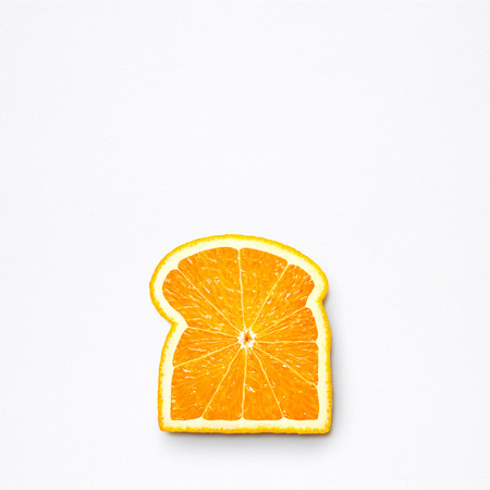 Healthy food concept and creative still life of bread slice made of fresh orange fruit.