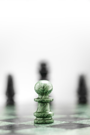 chequer: A pawn on the chequer before the shapes. Stock Photo