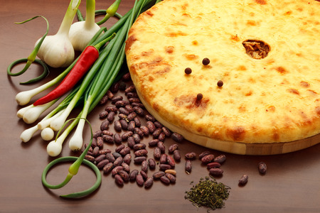 A colorful photo of traditional delicious beef osetinian pie. Traditional Ossetian feta cheese pie still life.