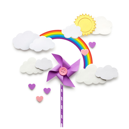 Creative valentines concept photo of a wind mill toy clouds and hearts made of paper on white background. Zdjęcie Seryjne