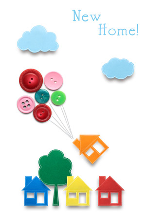 Creative concept photo of houses with air balloons made of paper on white background.