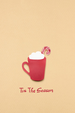 Creative concept photo of christmas coffee cup made of paper on brown background. Фото со стока