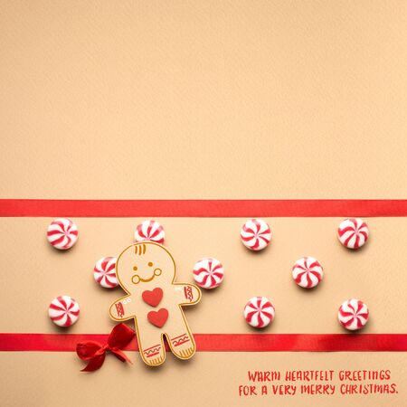 Creative concept photo of christmas candy and  gingerbread man on brown background. Stok Fotoğraf - 77060428