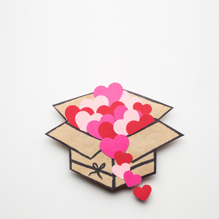 shaped: Creative valentines concept photo of a box full of hearts on white background. Stock Photo