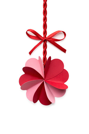 celebration background: Creative valentines concept photo of a flower made of paper hearts with a rope and a bow on white background.