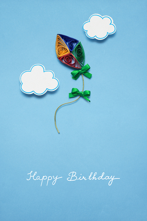Creative concept photo of a kite made of paper on blue background. Stock Photo - 77624218