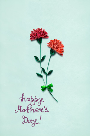 Creative mother day concept photo of flowers made of paper on int background.