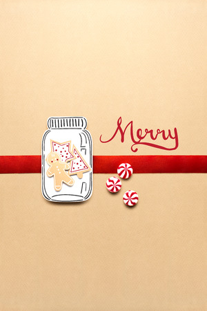 Creative concept photo of christmas candy and  gingerbread man on brown background. Stok Fotoğraf