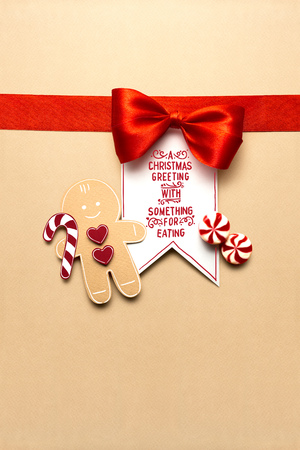 Creative concept photo of christmas candy and  gingerbread man on brown background. Stock Photo