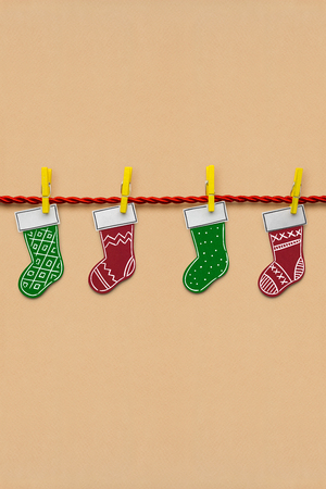 Creative photo of santas socks made  of paper on brown background.