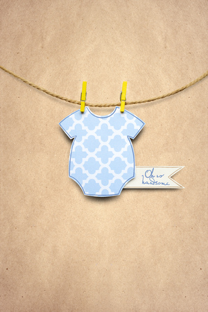 Creative concept photo of a childs jumpers made of paper on brown background.