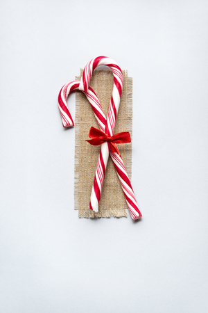 Creative concept photo of christmas lollypop candies on white background.
